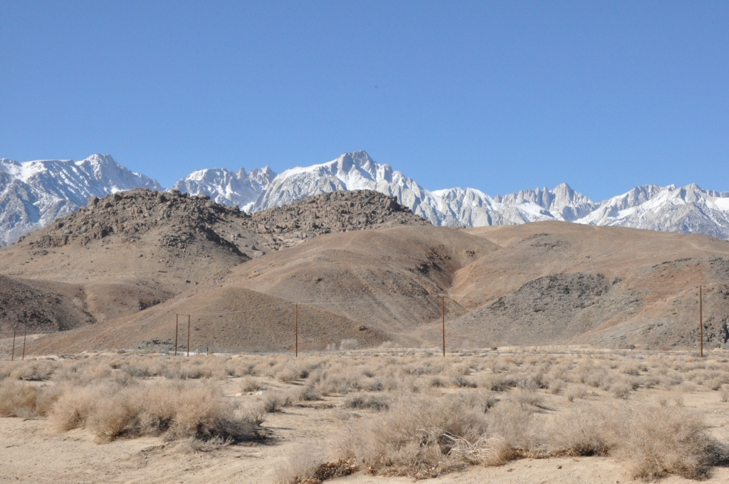 Mt.Whitney is the furthest peak on right side of photo. Alabama Hills are the brown ones in front-many movies and TV shows (Bonanza) shot here.