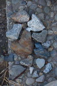Not one corner but two corners of this grave were decorated with heart rocks.