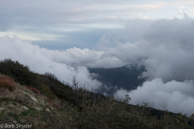 The clouds are lying in the valley below. The light blue color at about 11 on the photo was such a beautiful hue, it was quite dark before I came down the mountain.