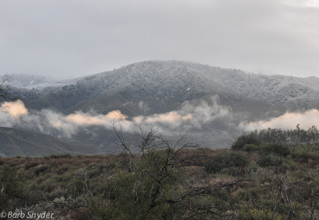 The view of Mt. Palomar from Vail  Lake during a snowy winter day in Southern California in 2013.