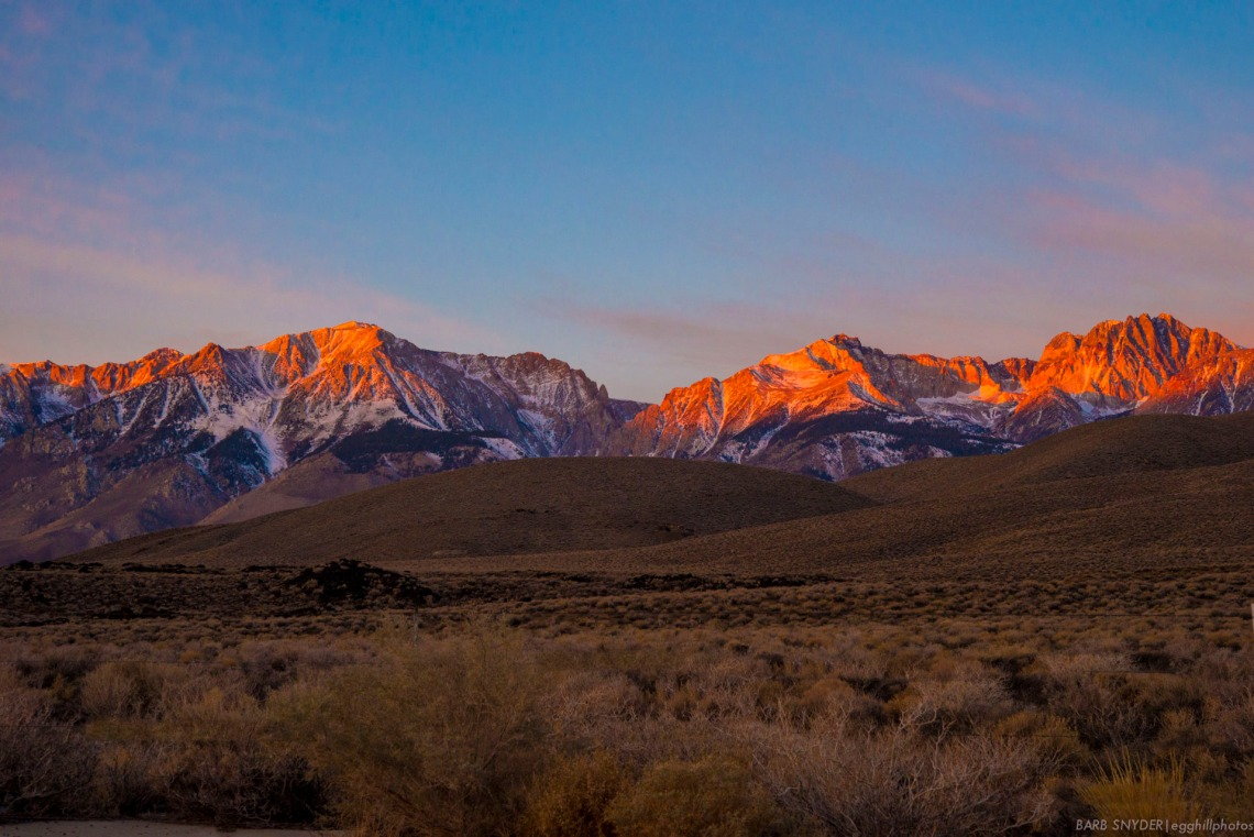 Dawn glow on the Sierras. You can see the White Mountain shadows on the lower part of the mountains.